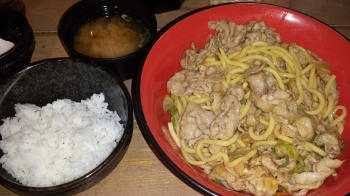 Pork and noodle dish with rice and a miso soup.