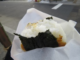 Grilled rice ball with miso. Picked this goodness up from a street vendor in Nagano.